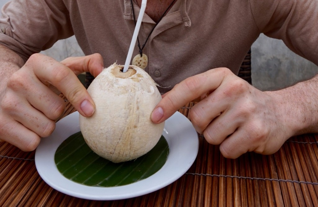 Drinking  a smoked coconut
