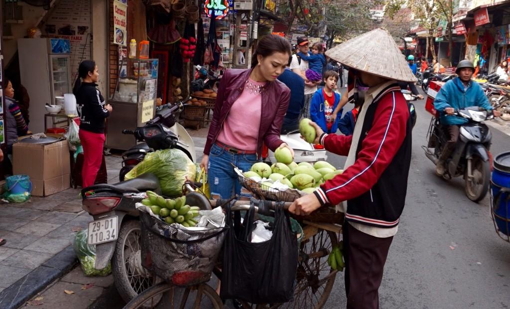 Hanoi biking fruit lady